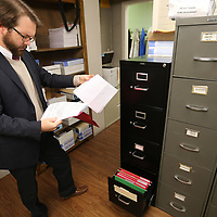 Dennis Farris Jr., looks over a file in municipal court in Tupelo Thursday.