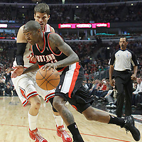16 March 2012: Portland Trail Blazers guard Jamal Crawford (11) drives past Chicago Bulls shooting guard Kyle Korver (26) during the Portland Trail Blazers 100-89 victory over the Chicago Bulls at the United Center, Chicago, Illinois, USA.