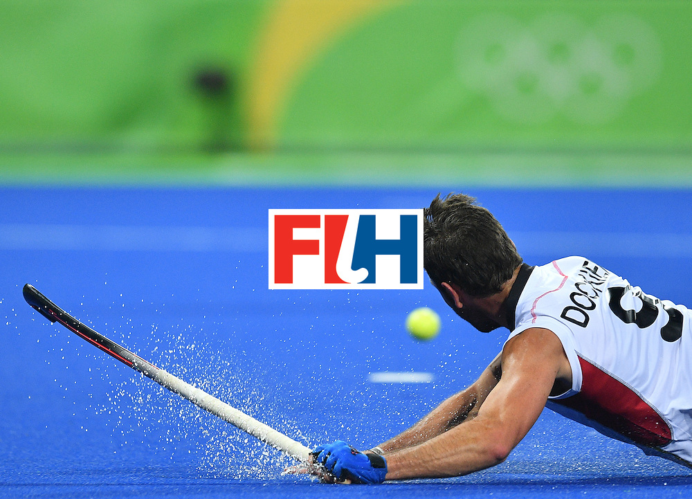 Belgium's Sebastien Dockier falls on the pitch during the men's semifinal field hockey Belgium vs Netherlands match of the Rio 2016 Olympics Games at the Olympic Hockey Centre in Rio de Janeiro on August 16, 2016. / AFP / Carl DE SOUZA        (Photo credit should read CARL DE SOUZA/AFP/Getty Images)
