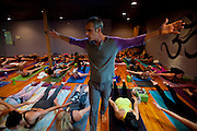 Brian Kest leads a high temp yoga session at Asana Fit studios in downtown San Clemente, CA on April 13, 2013.  (Photo by Aaron Schmidt © 2013)