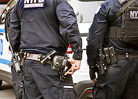 NYPD unit Anti-terrorism  counterterrorism Police officers carrying machine guns in Times Square  Manhattan New York City USA