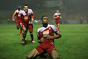 Whitehawk striker Danny Mills celebrates his opening goal during the The FA Cup 2nd Round Replay match between Whitehawk FC and Dagenham and Redbridge at the Enclosed Ground, Whitehawk, United Kingdom on 16 December 2015. Photo by Phil Duncan.