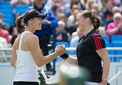 LIVERPOOL, ENGLAND - Saturday, June 18, 2011: Martina Hingis (SUI) and Chloe Murphy (GBR) during day three of the Liverpool International Tennis Tournament at Calderstones Park. (Pic by David Rawcliffe/Propaganda)