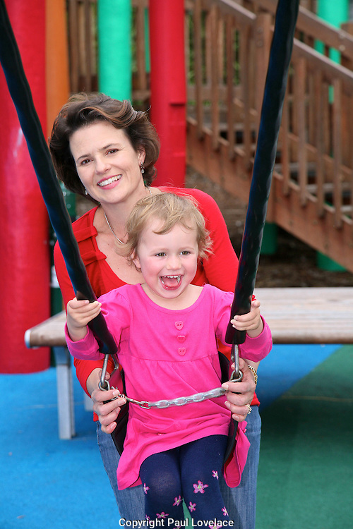 Mum & daughter playing in kids playground