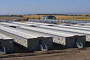 Target Logistics workers lodge, more commonly known as a &quot;mancamp&quot; just west of Tioga. The camps are constructed from prefabricated containers, and offer small clean functional rooms and good cafeteria food.<br /> <br /> This camp is the largest in the US and has a population of 1,053 and a 330m long corridor. They have a staff of 70 and consume between 40-60,000 lbs of food a week.<br /> <br /> Most workers here are employed by an oil services company and spend two weeks onsite, working15 hour days. they then get a week off to see their family. The pay makes it worthwhile as it is oftern double what they could get otherwise employed in the their professions.<br /> <br /> North Dakota oil boom. Based around the town of Williston, hydraulic fracturing, also known as 'fracking' has enabled a vast reserve of previously unobtainable oil to be accessed.