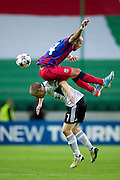 (UP) Steaua's Iasmin Latovlevici fights for the ball with (DOWN) Legia's Henrik Ojamaa during the UEFA Champions League play-off second leg match between Legia Warsaw and FC Steaua Bucuresti at Pepsi Arena Stadium in Warsaw on August 27, 2013.<br /> <br /> Poland, Warsaw, August 27, 2013<br /> <br /> Picture also available in RAW (NEF) or TIFF format on special request.<br /> <br /> For editorial use only. Any commercial or promotional use requires permission.<br /> <br /> Photo by &copy; Adam Nurkiewicz / Mediasport