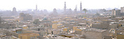 City of the Dead tombs and Cairo skyline, hazy skies