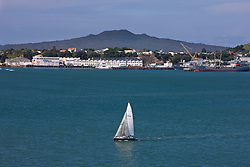 Sailboat in Waitemata Harbour, with Rangitoto Island in the background, Auckland, New Zealand