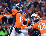 Denver Broncos quarterback Peyton Manning throws the football during the second half of their AFC Divisional Playoff game against the San Diego Chargers in Denver, Colorado, USA 12 January 2014. Denver won the game 24-17 to advance to the AFC Championship game against the New England Patriots.  EPA/BOB PEARSON
