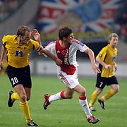 NLD/Amsterdam/20060928 - Voetbal, Uefa Cup voorronde 2006, Ajax - IK Start, Klaas Jan Huntelaar in duel met Bard Borgersen