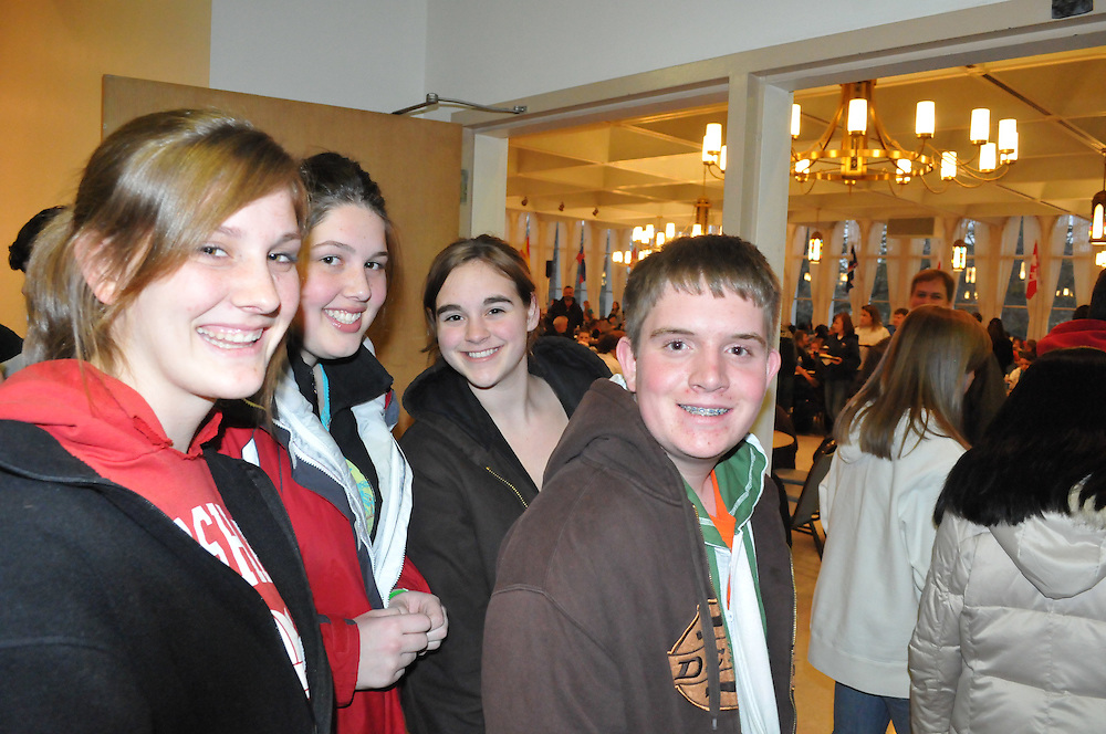 From Left, Tabi Weeden, Becca Krause, Bryanna Kurt, Juniors at St. Mary's Highschool in Marshall WI,  and Clinton Plowman and 8th grader at St. Charles in Hartland, WI break for dinner at the Wisconsin Catholic Youth Rally at Mount Mary College, Saturday March 28 2009.