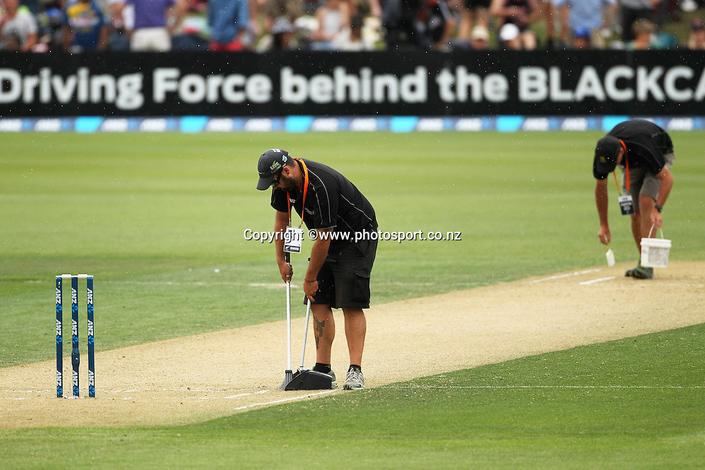 Groundsmen tend to the pitch during the first ODI cricket game between the Black Caps v Sri Lanka at Hagley Oval, Christchurch. 11 January 2015 Photo: Joseph Johnson / www.photosport.co.nz