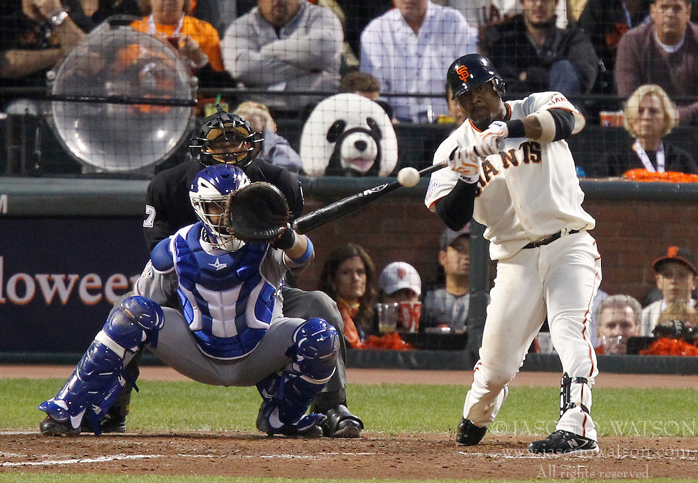 October 27, 2010; San Francisco, CA, USA;  San Francisco Giants shortstop Juan Uribe (5) at bat against the Texas Rangers during the fourth inning of game one of the 2010 World Series at AT&T Park.