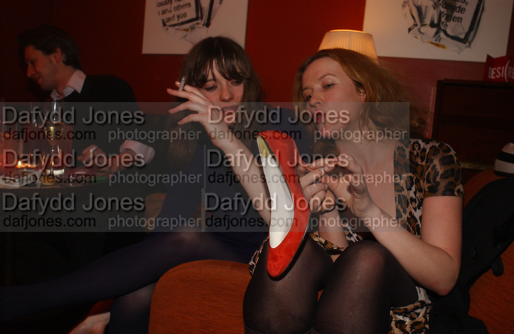 Iris Palmer and Cynnie Rainey wearing Cynnie Rainey shoes, DAZED AND CONFUSED GAP RED PARTY, Groucho Club, Dean st. London. 15 March 2006. ONE TIME USE ONLY - DO NOT ARCHIVE  © Copyright Photograph by Dafydd Jones 66 Stockwell Park Rd. London SW9 0DA Tel 020 7733 0108 www.dafjones.com