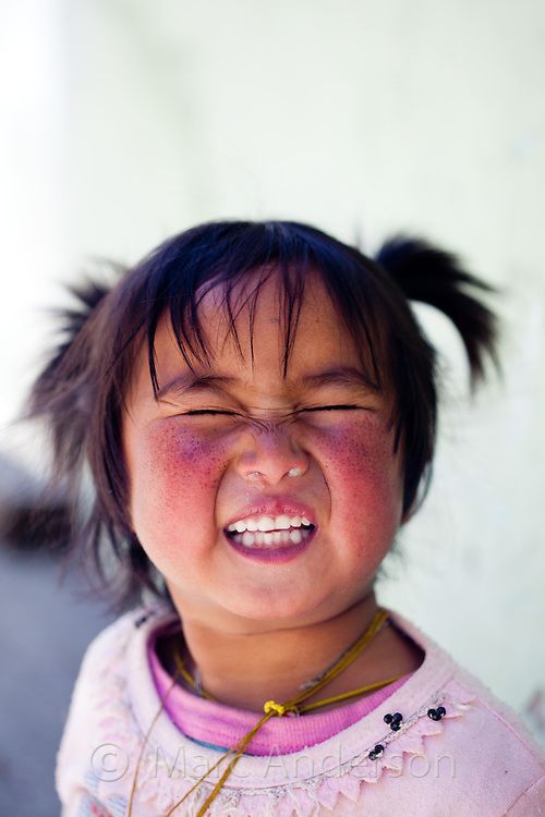 Young Nepali girl laughing, Langtang Valley, Nepal