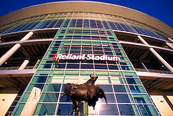 "Stock photo of the main entrance to Reliant Stadium featuring ""Spirit of the Bull"" Monument by Walter T. Matia"