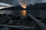 The last rays of sunlight fade behind the Teton Mountains and Jenny Lake in Jackson, Wyoming on October 3, 2014.