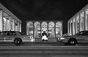 New York City: Cabs and solitary figure outside Lincoln Center