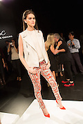 Orange and gray print trousers with a sleeveless jacket and sleeveless T. By Monika Chiang at Spring 2013 Fashion Week in New York.