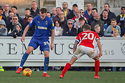 AFC Wimbledon striker Joe Pigott (39) taking on Charlton Athletic midfielder Chris Solly (20) during the EFL Sky Bet League 1 match between AFC Wimbledon and Charlton Athletic at the Cherry Red Records Stadium, Kingston, England on 23 February 2019.
