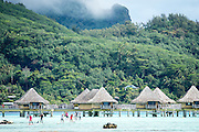 Racers past the iconic bungaloes of Bora Bora.