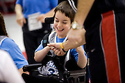 "Kellogg Foundation Assignment: Wheelchair Basketball..Keaton Shoemaker laughs as he gets a hi-five...The contact is Pam Patula, 888/957-6245 runs an organization.called Socil (S.E. center for Independent Living )a member of April.  A weekly wheelchair basketball game in Lancaster, held on Jan 20th. Saturday at 10am. The basketball coach, Brett Harbage, is an Independent Living Specialist from SOCIL.  Other coach is Cheryl ""Hutch"" Hutchinson, she is the adaptive physical education instructor of Fairfield County.  The adaptive basketball games are part of the Upward Basketball league, .  This is only Upwards adaptive league in the nation."