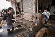Men working at metal recycling steel in Dazu County, Chongqing, China