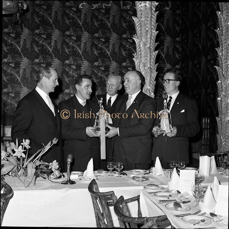 24/01/1962.01/24/1962.24 January 1962.Gaelic sports journalists awards dinner at the Gresham Hotel, Dublin. .Mr. Hugh Byrne, president of the G.A.A. presents Liam Devaney (Tipperary) with the Association of Gaelic Sports Journalists award as Hurler of the Year. Included in the picture is the Footballer of the Year, Gerry O'Malley (Roscommon)on right); The minister for Industry and Commerce, Mr Jack Lynch T.D. (on left); and the Secretary of the G.A.A., Padraig O'Caoimh (centre).
