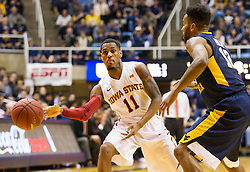 Feb 22, 2016; Morgantown, WV, USA; Iowa State Cyclones guard Monte Morris (11) passes to a teammate during the first half against the West Virginia Mountaineers at the WVU Coliseum. Mandatory Credit: Ben Queen-USA TODAY Sports