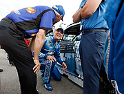 NASCAR Cup Series driver Kevin Harvick reacts as he visits with team members before the start of a NASCAR Cup Series auto race at Kansas Speedway in Kansas City, Kan., Saturday, May 12, 2018. (AP Photo/Colin E. Braley)