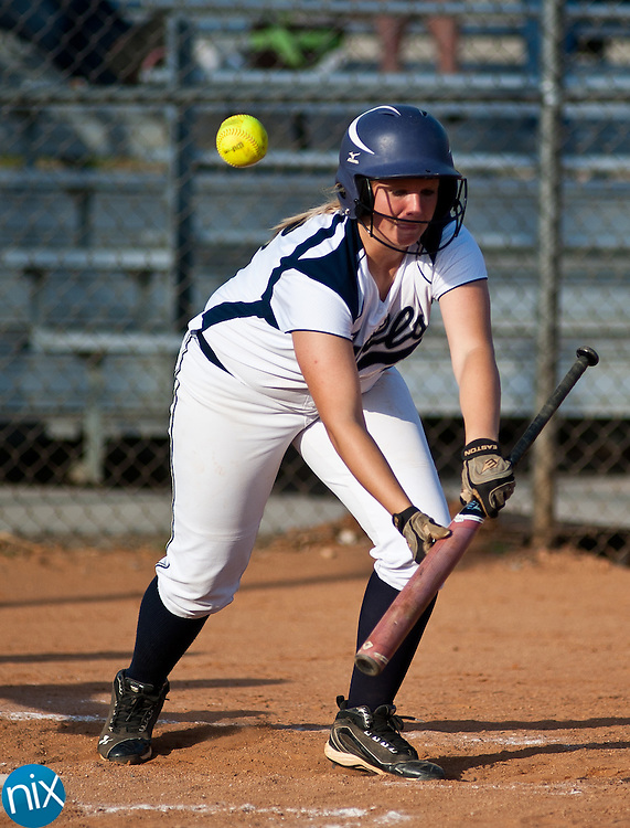 Hickory Ridge's Julia Sanders bunts against Concord in South Piedmont Conference softball action Tuesday afternoon in Harrisburg. Hickory Ridge won the game 7-1.  (Photo by James Nix)