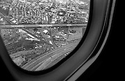 """View from plane window over Newark, NJ...Part of long-term (2005-2008) story """"I See A Darkness""""."""