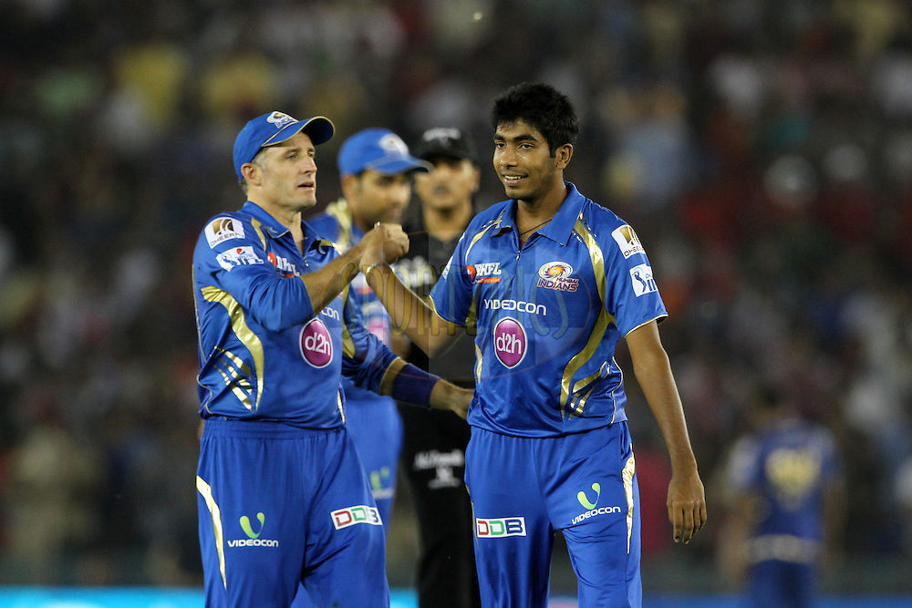 Michael Hussey , Jasprit Bumrah of the Mumbai Indians  celebrates the wicket of George Bailey of the Kings X1 Punjab during match 48 of the Pepsi Indian Premier League Season 2014 between the Kings XI Punjab and the Mumbai Indians held at the Punjab Cricket Association Stadium, Mohali, India on the 21st May  2014<br /> <br /> Photo by Deepak Malik / IPL / SPORTZPICS<br /> <br /> <br /> <br /> Image use subject to terms and conditions which can be found here:  http://sportzpics.photoshelter.com/gallery/Pepsi-IPL-Image-terms-and-conditions/G00004VW1IVJ.gB0/C0000TScjhBM6ikg