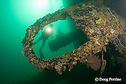 divers explore the wreck of the El Capitan / USS Majaba, an American freighter of 90 m length, sunk in 1946 in Subic Bay, Philippines, lying on its side at a depth of 5-21 m; MR 378, 379