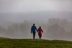 © Licensed to London News Pictures. 05/02/2020. London, UK. Walkers enjoy the dense fog in Richmond Park this morning as weather experts predict more fog followed by high winds and heavy rain for the weekend. Photo credit: Alex Lentati/LNP