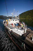 The MV Uchuck III supply vessel also falls into the role of a tourist attraction taking on passengers interested in viewing the operations of supplying the small coastal villages on Western Vancouver Island's remote shores.  Vancouver Island, British Columbia, Canada.