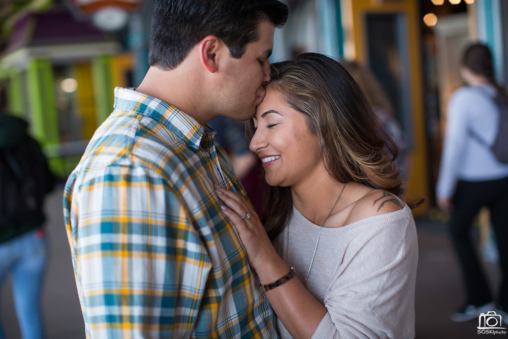 Marissa Susbilla and Zachary Canez pose for their portraits during their engagement session at Santa Cruz Beach Boardwalk in Santa Cruz, California, on April 17, 2014. (Stan Olszewski/SOSKIphoto)<br /> <br /> *** Wedding Registry ***<br /> <br /> Purchase Gift Cards in various prices at a discounted rate of 20% for your loving couple to use for SOSKIphoto Products and Services. Your couple will be notified of your generous gift.<br /> <br /> How to complete your Wedding Registry Gift Card Order:<br /> 1. Choose your favorite photo of them,<br /> 2. Click the blue Add to Cart icon, <br /> 3. Select your desired Gift Card,<br /> 4. Mix & match quantity to fit your price point,<br /> 5. Click the green Add to Cart icon,<br /> 6. Click Check Out & follow prompts.