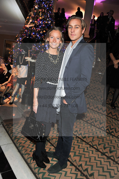 MARTHA WARD and TOBY KNOTT at the unveiling of the Claridge's Christmas tree 2011 designed by Alber Elbaz for Lanvin held at Claridge's, Brook Street, London on 5th December 2011.