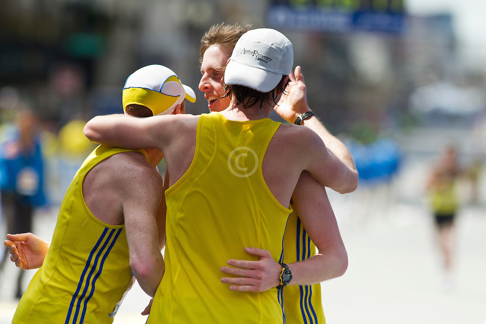 2013 Boston Marathon: BAA teammates celebrate together after finishing: Ryan McCalmon, Ian Nurse, Peter Gilmore,