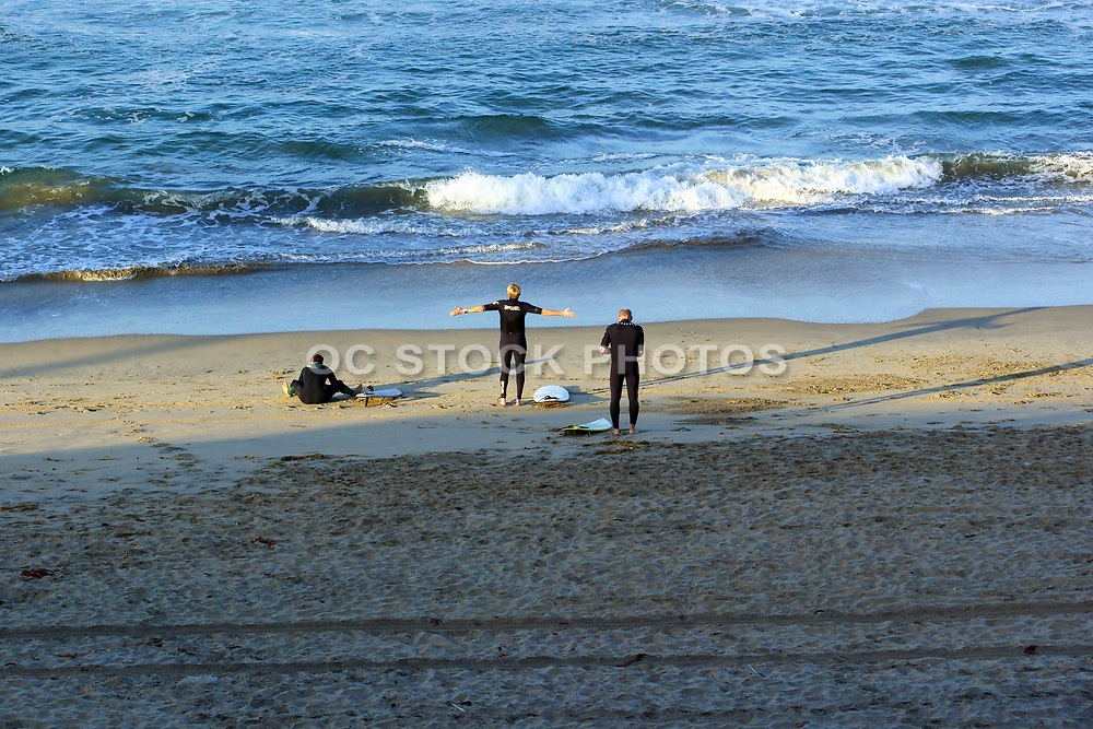 Surfers on the Sand Getting Ready in Huntington Beach California