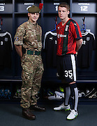 Dundee's Calvin Colquhoun models the new Dundee commemorative kit with the Black Watch's Lewis Mitchell - The Dee will wear this kit against Ross County on Saturday 26th September to commemorate the centenary of the Battle of Loos. The kit includes the Regimental badge and tartan of the Black Watch<br /> <br /> Dundee are offering free tickets for the match to current and former members of the Armed Forces.<br /> <br /> &copy; David Young<br /> davidyoungphoto@gmail.com<br /> www.davidyoungphoto.co.uk