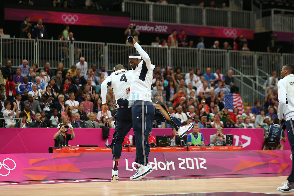 LeBron James of the USA warms up with Tyson Chandler against France during Day 2 of the London Olympic Games in London, England, United Kingdom on 29 Jul 2012..(Jed Jacobsohn/for The New York Times)....