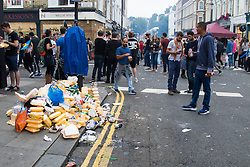 London, August 30th 2015. Rubbish piles up and street food stalls enjoy brisk trade as revellers enjoy day one of the Notting Hill Carnival.