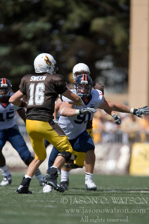 Virginia defensive end Chris Long (91) pursues Wyoming quarterback Karsten Sween (16).  The Wyoming Cowboys defeated the Virginia Cavaliers 23-3 at War Memorial Stadium in Laramie, WY on September 1, 2007.