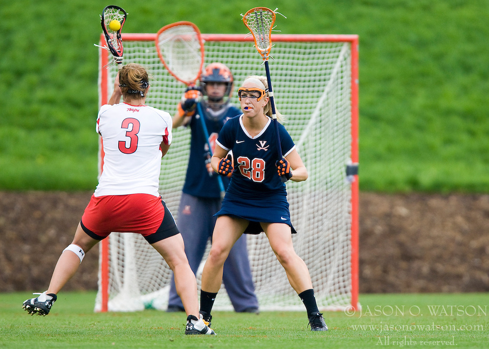Virginia Cavaliers A Megan O'Malley (28) defends Maryland Terrapins Midfield Caitlyn McFadden (3).  The #3 ranked Virginia Cavaliers defeated the #2 ranked Maryland Terrapins 10-9 in overtime in the finals of the Women's 2008 Atlantic Coast Conference Lacrosse tournament at the University of Virginia's Scott Stadium in Charlottesville, VA on April 27, 2008.