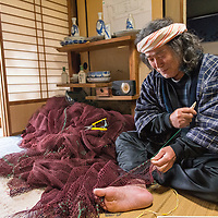 Keitaro Nagaoka is a fisherman, painter, and herbalist who has lived on the Oki Islands for 38 years. An expert on fishing and mountain herbs, he trains apprentice fishermen and shares his knowledge of rare plants with the community. He is pictured in his home in Saigo Port on Dogo, the largest island of the Oki Islands, an archipelago in the Sea of Japan, Shimane Prefecture, Japan.