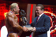 March 1, 2014 - Columbus, Ohio, U.S - <br /> <br /> Bodybuilding 2014 - Arnold Classic<br /> <br /> ARNOLD SCHWARZENEGGER presents DENNIS WOLF with his trophy after Wolf won the 2014 Arnold Classic at the Arnold Sports Festival in Columbus, Ohio.<br /> ©Exclusivepix