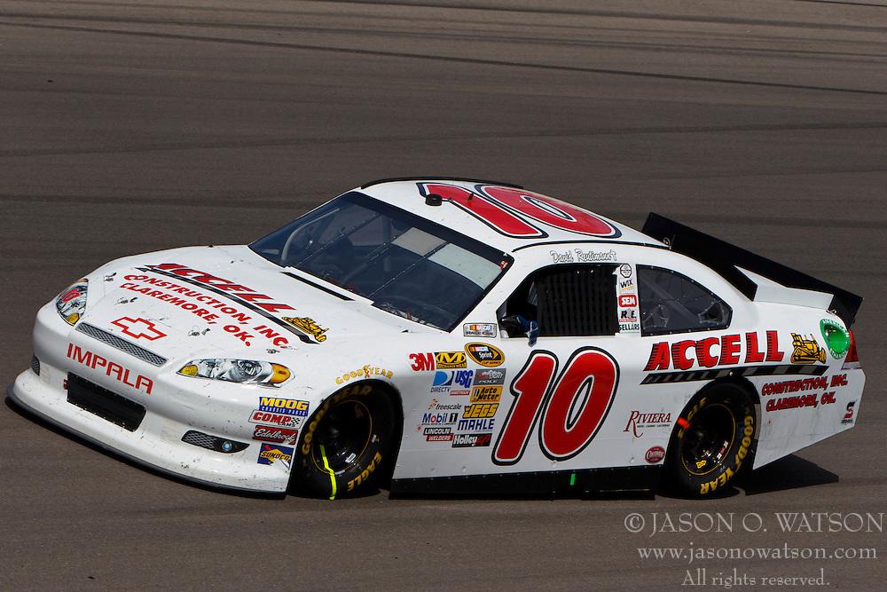 Mar 11, 2012; Las Vegas, NV, USA;  Sprint Cup Series driver David Reutimann (10) during the Kobalt Tools 400 at Las Vegas Motor Speedway. Mandatory Credit: Jason O. Watson-US PRESSWIRE