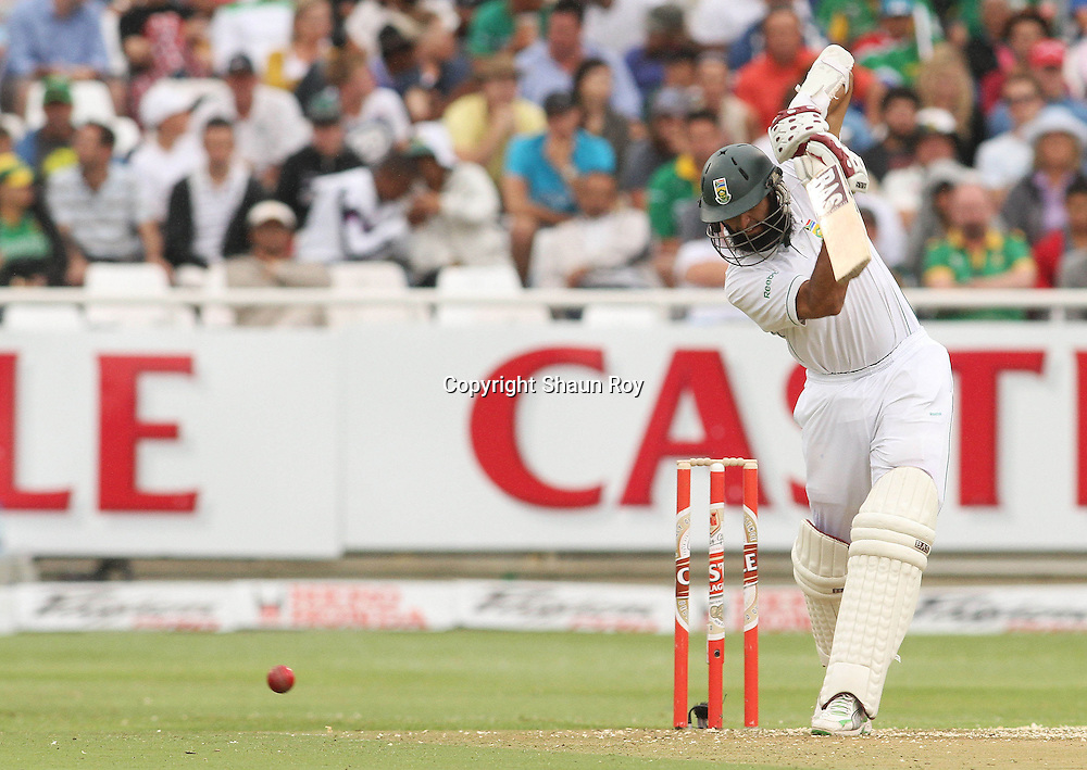 CAPE TOWN, SOUTH AFRICA - 2 January 2011, Hushim Amla of South Africa cover drives a delivery towards the boundary during day 1 of the 3rd Castle Test between South Africa and India held at Sahara Park Newlands Stadium in Cape Town, South Africa on the 2 January 2011 .Photo by: Shaun Roy