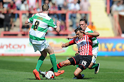 Exeter City's Alex Nicholls is tackled by Yeovil Town's Marc Laird - Photo mandatory by-line: Harry Trump/JMP - Mobile: 07966 386802 - 08/08/15 - SPORT - FOOTBALL - Sky Bet League Two - Exeter City v Yeovil Town - St James Park, Exeter, England.